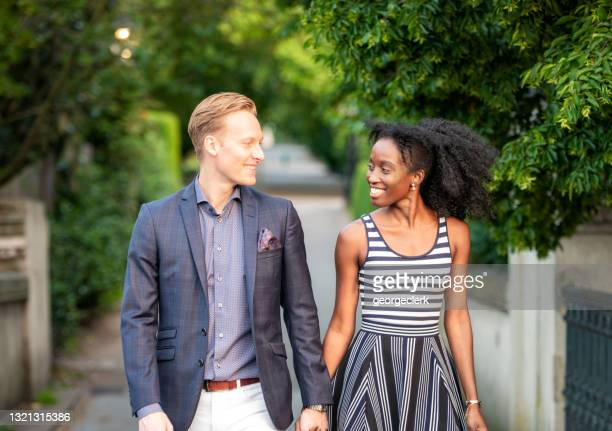 enjoying time together - mid adult couple stock pictures, royalty-free photos & images
