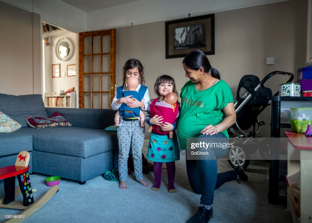 Enjoying Time With Their Mother : Stock Photo