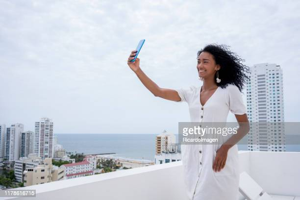 enjoying vacations - white dress stock pictures, royalty-free photos & images