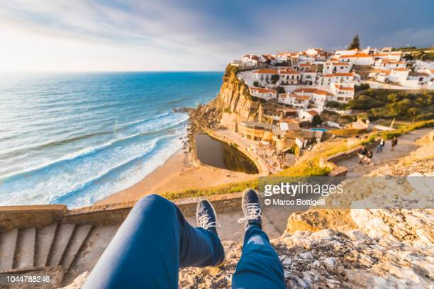 enjoying view over the ocean from personal perspective in azenhas do mar, portugal - viewpoint stock photos and pictures