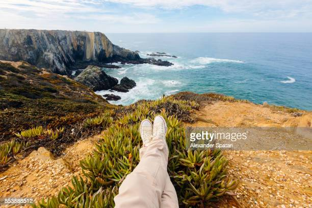 enjoying view over the ocean from personal perspective - male feet stock photos and pictures