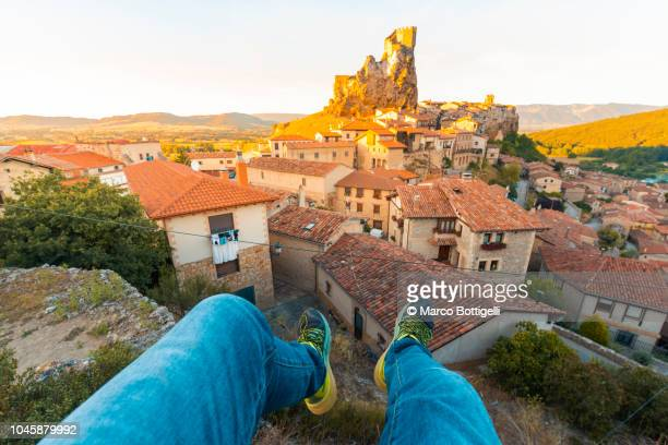 enjoying view over the roofs from personal perspective in frias, spain. - medieval shoes stock pictures, royalty-free photos & images