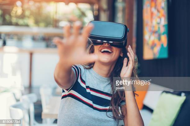 enjoying virtual reality technology - virtual reality simulator stock photos and pictures