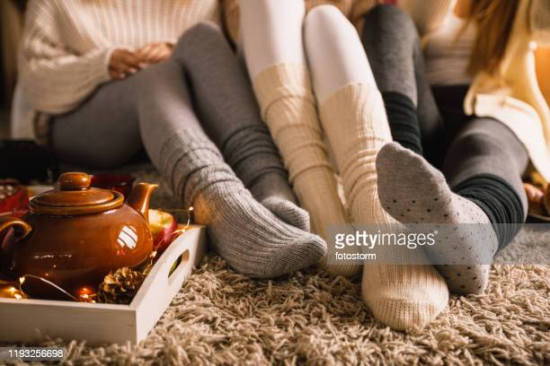 enjoying warm tea in cozy sock on a cold autumn day - cosy stock pictures, royalty-free photos & images
