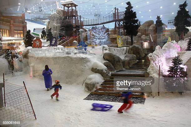 Enjoying winter in Ski Dubai Mall of the Emirates Dubai UAE