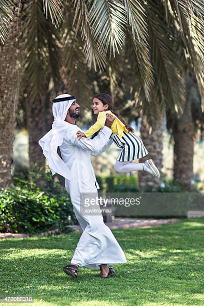 Enjoying with her father in the park