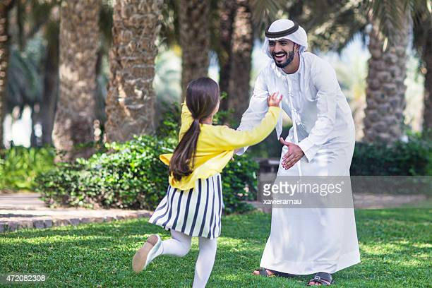 Enjoying with her father