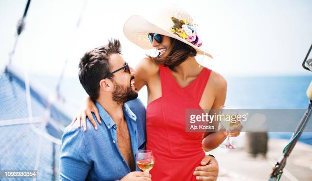 enjoying yacht party. - beautiful people stock pictures, royalty-free photos & images