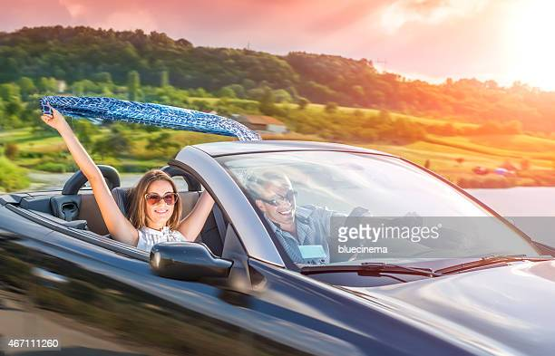 Enjoying your life in a cabriolet car