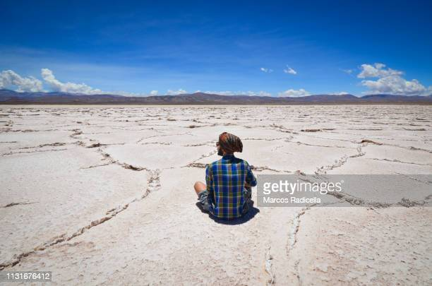 enjoyng the silence in salta province, salinas grandes, argentina - salta argentina stock photos and pictures