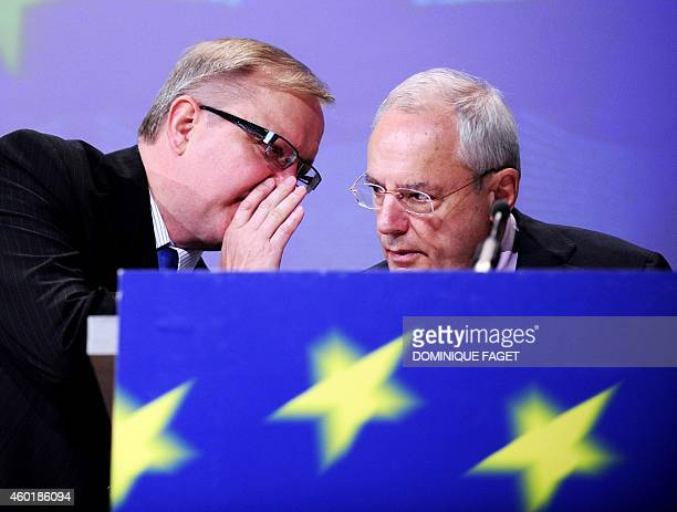 EU Enlargement Commissioner Olli Rehn speaks to European Commission VicePresident Jacques Barrot during a press conference on Visa travel for...