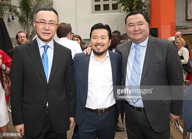 Enlight Pictures CEO Wang Changtian Justin Lin and Sun Seven Stars Chairman Bruno Wu attend the 88th Birthday Of TLC Chinese Theater IMAX Honoring...