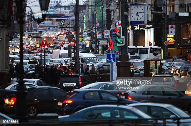 Enlighted Metro sign and traffic at rush hour around revolution square on October 14 2009 in Moscow Russia Moscow is the biggest European City with...