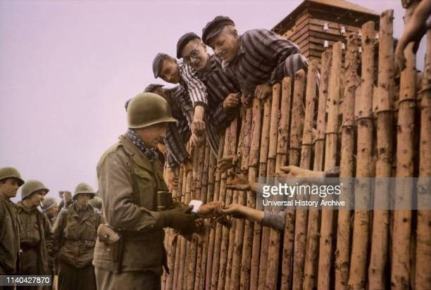 Enlisted Man of Seventh US Army Giving Cigarettes to Liberated Prisoners Dachau Germany Central Europe Campaign Western Allied Invasion of Germany...
