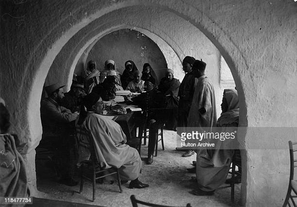 Enlisting Tunisians for the French Army in a mosque in the presence of two French officers and one Beylical officer during World War One on the...