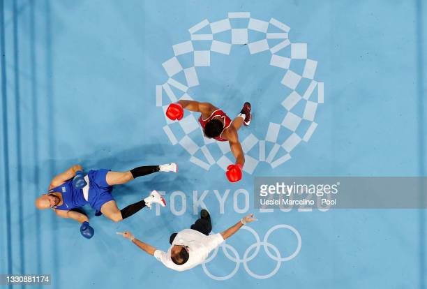Enmanuel Reyes Pla of Spain celebrates after he knocks down Vassily Levit of Kazakhstan during the Men's Heavy on day four of the Tokyo 2020 Olympic...