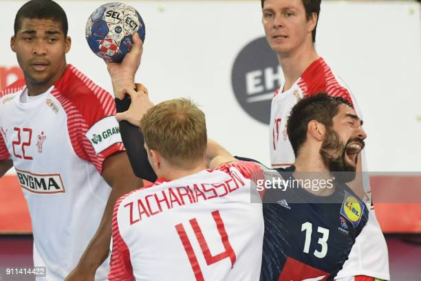 enmark's Anders Zachariassen hold off France's Nikola Karabatic during the match for third place of the Men's 2018 EHF European Handball Championship...