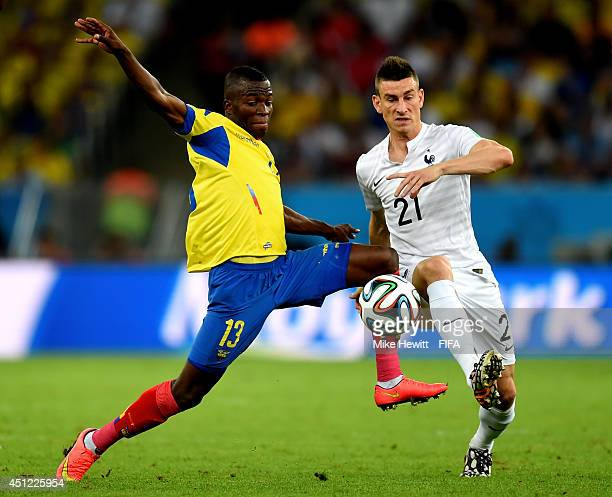 Enner Valencia of Ecuador and Laurent Koscielny of France compete for the ball during the 2014 FIFA World Cup Brazil Group E match between Ecuador...
