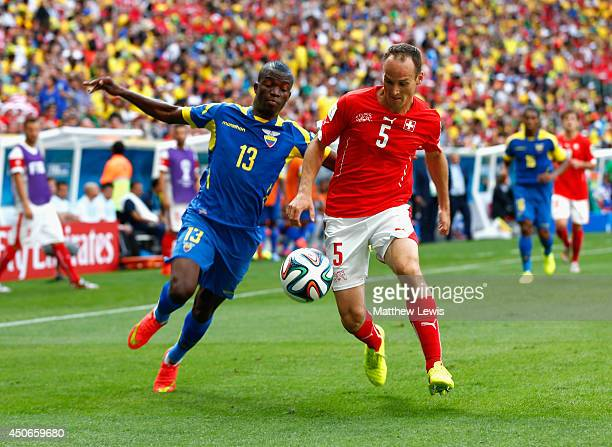 Enner Valencia of Ecuador and Steve von Bergen of Switzerland battle for the ball during the 2014 FIFA World Cup Brazil Group E match between...