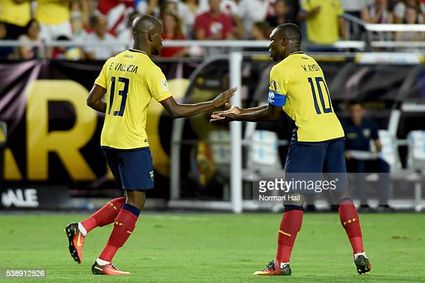 Enner Valencia of Ecuador celebrates with teammate Walter Ayovi after scoring the first goal of his team during a group B match between Ecuador and...