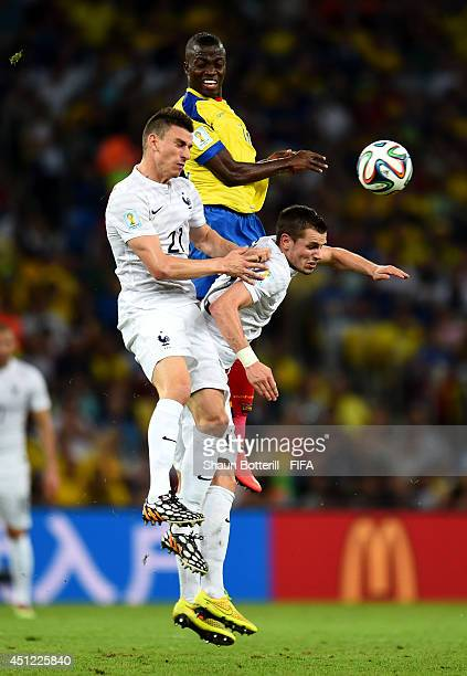 Enner Valencia of Ecuador competes for the ball agains Laurent Koscielny and Morgan Schneiderlin of France during the 2014 FIFA World Cup Brazil...