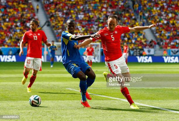 Enner Valencia of Ecuador competes for the ball with Steve von Bergen of Switzerland during the 2014 FIFA World Cup Brazil Group E match between...