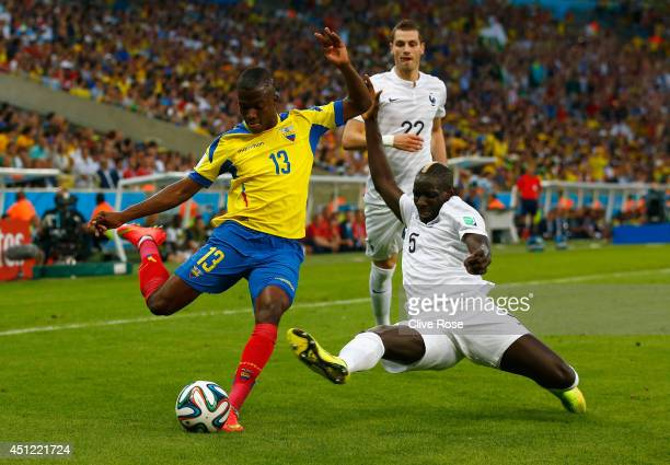 Enner Valencia of Ecuador is challenged by Mamadou Sakho of France during the 2014 FIFA World Cup Brazil Group E match between Ecuador and France at...