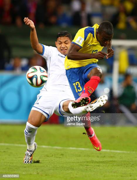 Enner Valencia of Ecuador shoots against Emilio Izaguirre of Honduras during the 2014 FIFA World Cup Brazil Group E match between Honduras and...