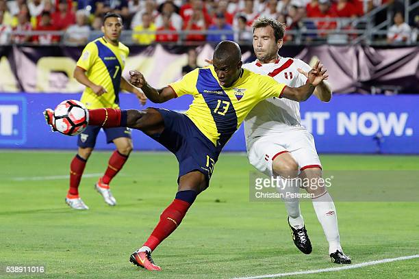 Enner Valencia of Ecuador shoots to score goal past Raul Ruidiaz of Peru during the first half of the 2016 Copa America Centenario Group B match at...