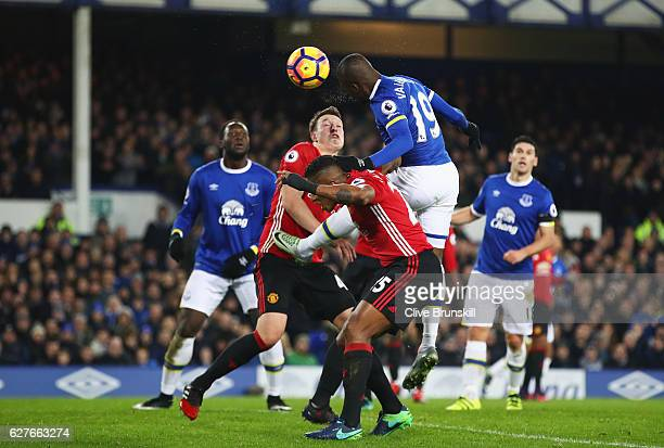 Enner Valencia of Everton outjumps Antonio Valencia and Phil Jones of Manchester United to head at goal during the Premier League match between...