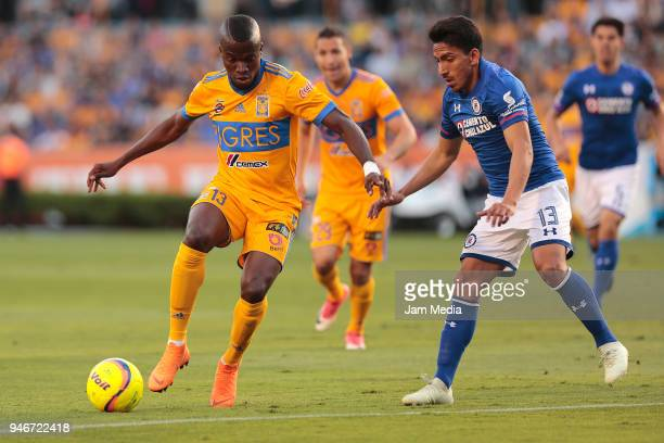 Enner Valencia of Tigres and Angel Mena of Cruz Azul fight for the ball during the 15th round match between Tigres UANL and Cruz Azul as part of the...