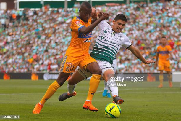 Enner Valencia of Tigres and Jesus Angulo of Santos fight for the ball during the quarter finals second leg match between Santos Laguna and Tigres...