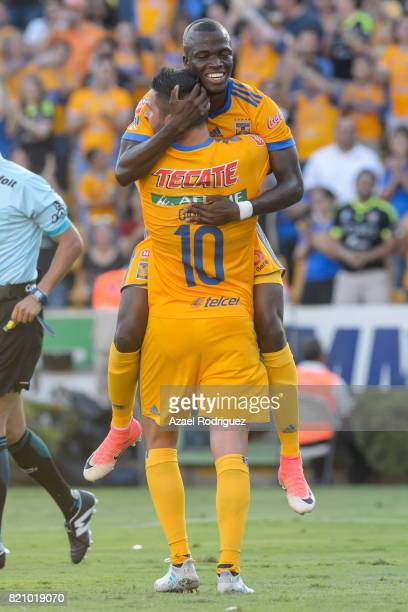 Enner Valencia of Tigres celebrates with teammate Andre Gignac after scoring his team's second goal during the 1st round match between Tigres UANL...