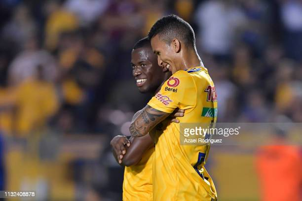 Enner Valencia of Tigres celebrates with teammate Francisco Meza after scoring his team's second goal via penalty during a round of sixteen second...