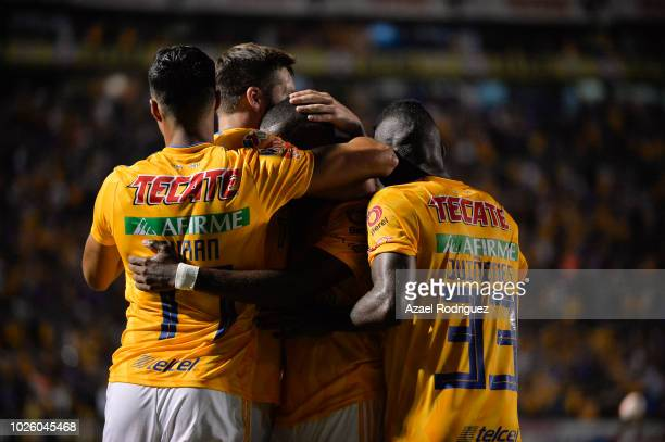 Enner Valencia of Tigres celebrates with teammates after scoring his teams third goal during the 6th round match between Tigres UANL and Veracruz as...