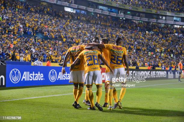Enner Valencia of Tigres celebrates with teammates after scoring his team's second goal during the semifinal match between Tigres UANL and Santos...