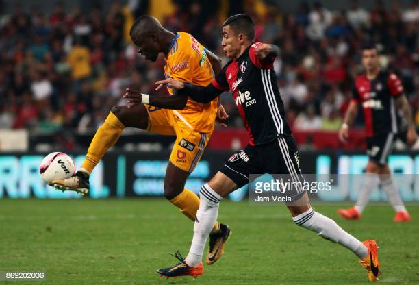 Enner Valencia of Tigres controls the ball while Luis Reyes of Atlas defends during the 8nd round match between Atlas and Tijuana as part of the...