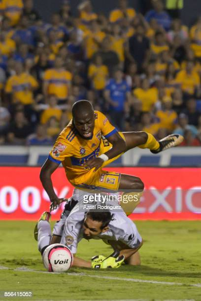 Enner Valencia of Tigres crashes with Rodolfo Cota goalkeeper of Chivas during the 12th round match between Tigres UANL and Chivas as part of the...