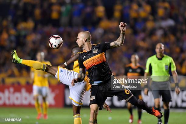 Enner Valencia of Tigres fights for the ball with Aljaz Struna of Houston Dynamo during the match between Tigres UANL and Houston Dynamo as part of...