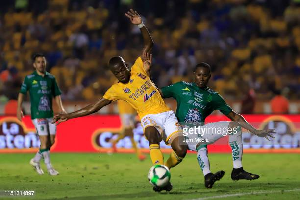 Enner Valencia of Tigres fights for the ball with Andres Mosquera of Leon during the Final first leg match between Tigres UANL and Leon as part of...