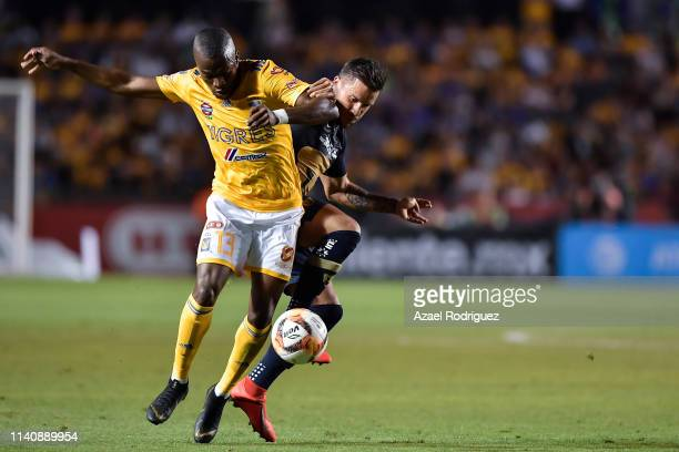 Enner Valencia of Tigres fights for the ball with Andrés Iniestra of Pumas during the 23th round match between Tigres UANL and Pumas UNAM as part of...