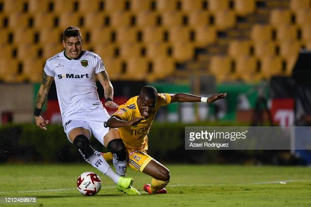 Enner Valencia of Tigres fights for the ball with Bruno Romo of Juárez during the 10th round match between Tigres UANL and FC Juarez as part of the...