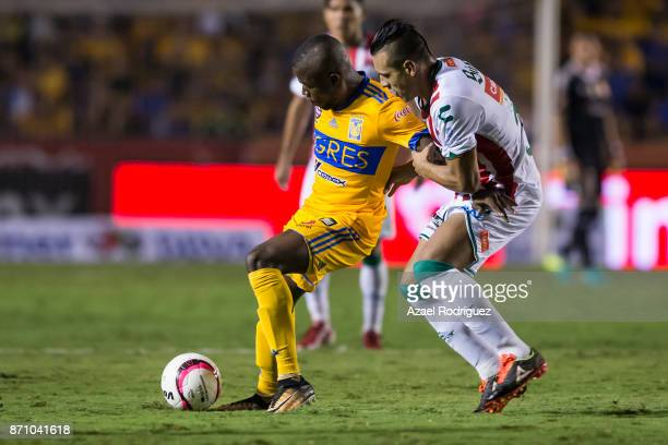 Enner Valencia of Tigres fights for the ball with Carlos Gonzalez of Necaxa during the 16th round match between Tigres UANL and Necaxa as part of the...