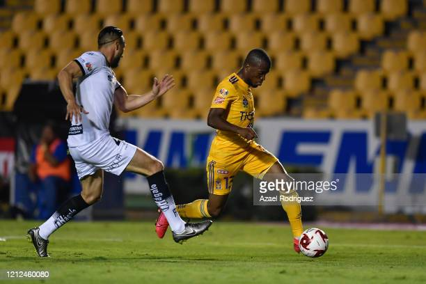 Enner Valencia of Tigres fights for the ball with Diego Rolán of Juárez during the 10th round match between Tigres UANL and FC Juarez as part of the...