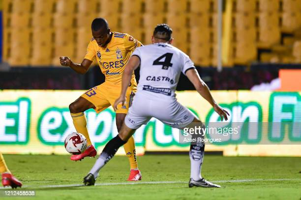 Enner Valencia of Tigres fights for the ball with Elio Castro of Juárez during the 10th round match between Tigres UANL and FC Juarez as part of the...