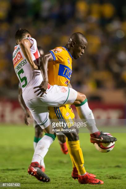Enner Valencia of Tigres fights for the ball with Igor Lichnovsky of Necaxa during the 16th round match between Tigres UANL and Necaxa as part of the...
