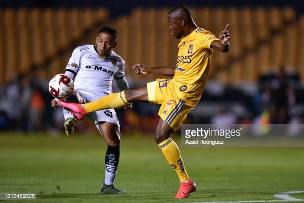 Enner Valencia of Tigres fights for the ball with Jefferson Intriago of Juárez during the 10th round match between Tigres UANL and FC Juarez as part...