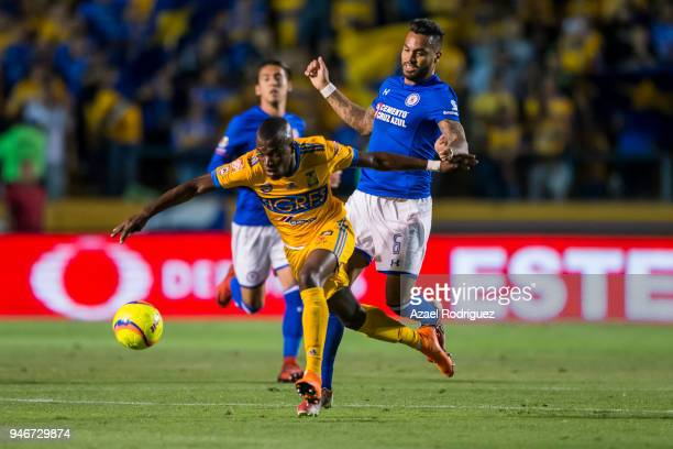 Enner Valencia of Tigres fights for the ball with Julian Velazquez of Cruz Azul during the 15th round match between Tigres UANL and Cruz Azul as part...