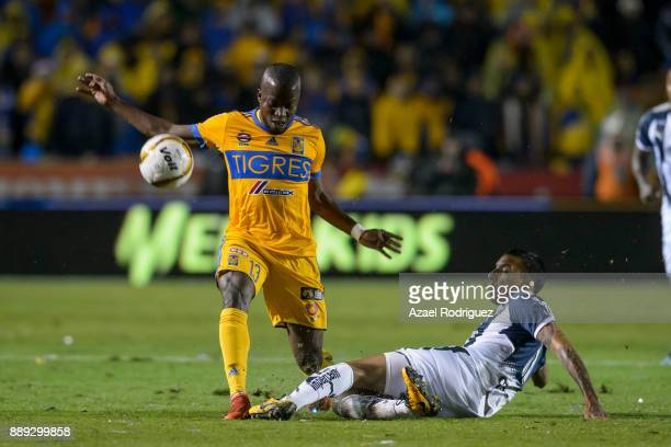 Enner Valencia of Tigres fights for the ball with Leonel Vangioni of Monterrey during the first leg of the Torneo Apertura 2017 Liga MX final between...