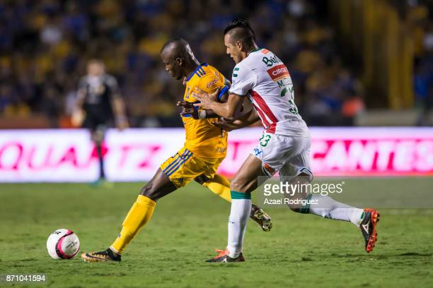 Enner Valencia of Tigres fights for the ball with Mario de Luna of Necaxa during the 16th round match between Tigres UANL and Necaxa as part of the...